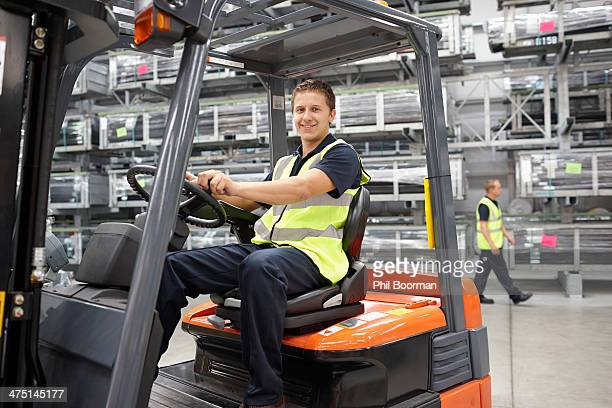 Forklift truck driver in engineering warehouse