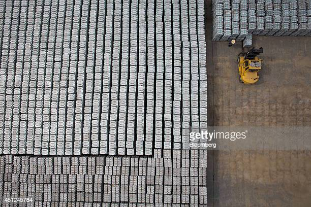 A forklift truck driver moves stacks of aluminum ingots at the Public Procurement Service warehouse in Gunsan South Korea on Wednesday June 25 2014...