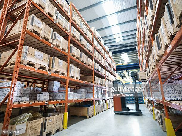 Forklift truck in parts store in factory