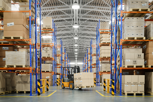 Forklift truck in warehouse or storage and shelves with cardboard boxes. 1125121546