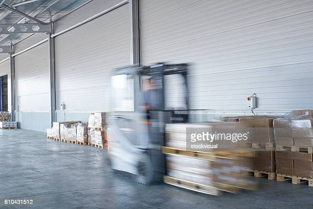 forklift truck loading lorry - loading dock stock pictures, royalty-free photos & images