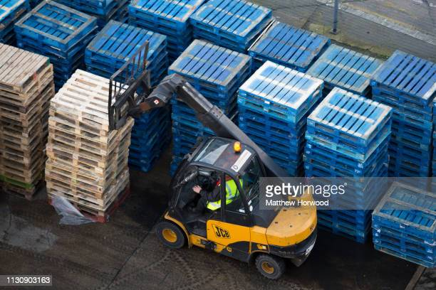 A forklift truck moves wooden pallets at the Port of Southampton on February 10 2019 in Southampton England The Port of Southampton is a passenger...