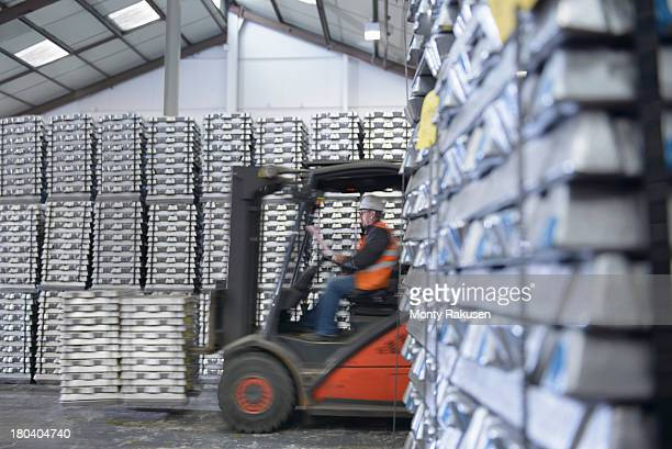 Forklift truck moving stock in warehouse