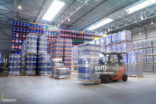 forklift truck storing barrels in oil blending factory - oil barrel stock pictures, royalty-free photos & images