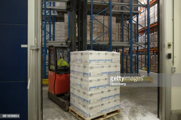 A forklift truck transports a crate of frozen Lutosa Foods SA shoestring fries inside a storage freezer at Antwerp Cold Stores at the Port of Antwerp...