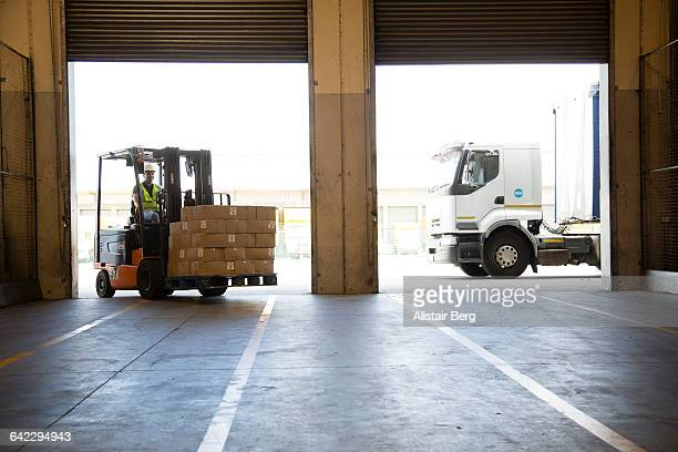 Forklift truck unloading a lorry