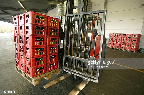 Forklift truck with pallet watercase in the mineral water company Apollinaris Schweppes GmbH
