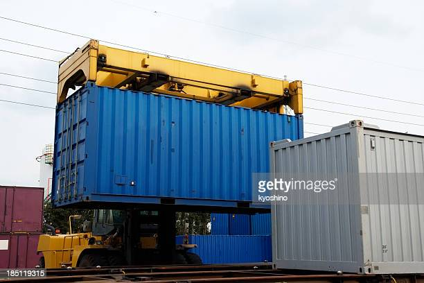 forklift with driver loading a container - rail freight stock pictures, royalty-free photos & images