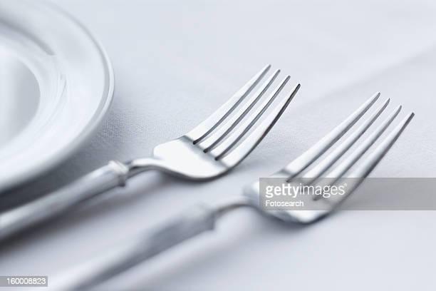 forks on dining table - enfoque diferencial fotografías e imágenes de stock