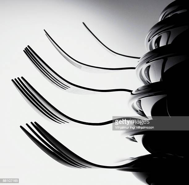 Forks stacked between plates