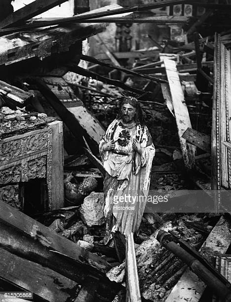 A forlorn statue of Christ still stands in the rubble of a church in the warblasted town of Dulag on the Philippines' Leyte Island | Location Dulag...