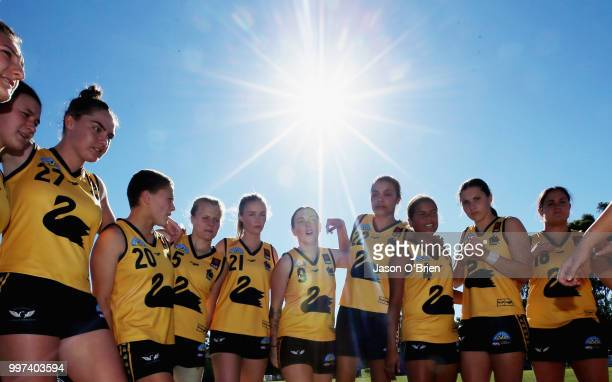 WA form a huddle during the AFLW U18 Championships match between Vic Country and Western Australia at Bond University on July 13 2018 in Gold Coast...