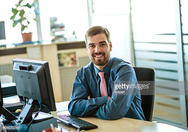 Formal businessman in office with businesswoman writing EU project proposal