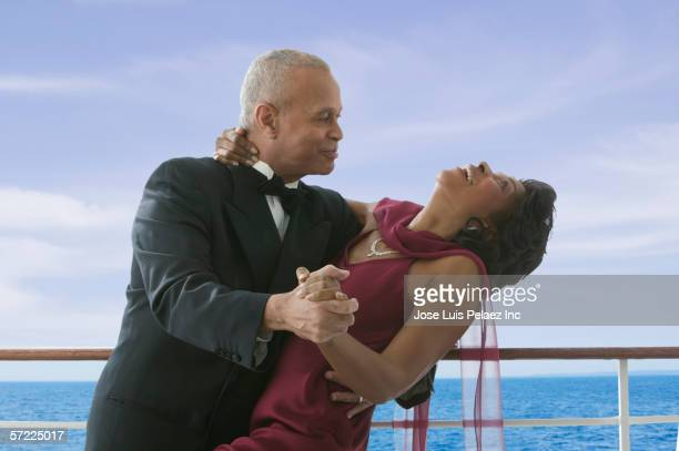 formal couple dancing on cruise ship - gewalt stockfoto's en -beelden