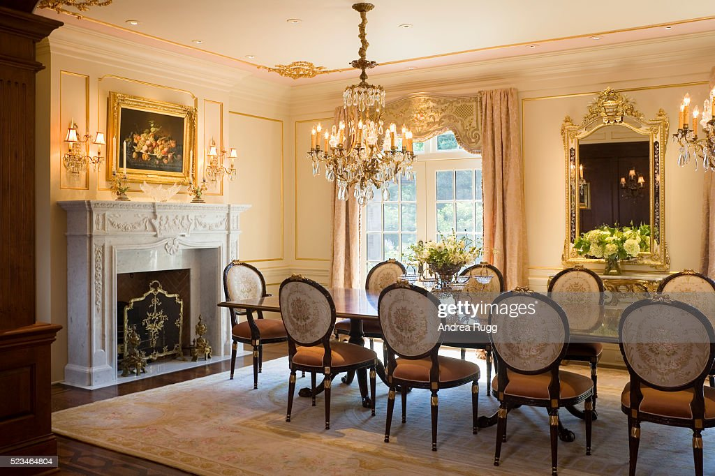 Formal Dining Room With White Marble Fireplace Mantel Stock Photo