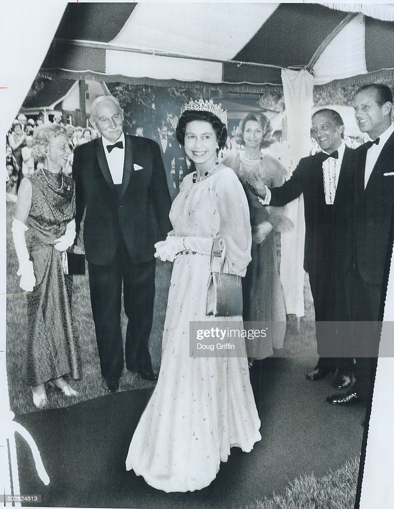 Formal Gown with soft; full sleeves which Queen Elizabeth wore to a reception at Leonard Hall; Queen : News Photo