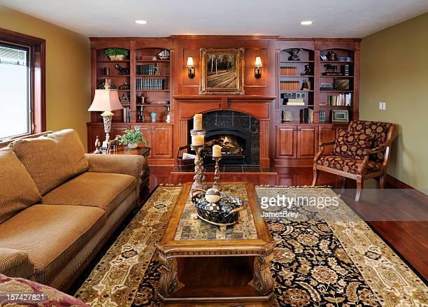 sala de estar formal interior de casa, o armário de madeira-de-lei, lareira, tapete persa - persian rug - fotografias e filmes do acervo