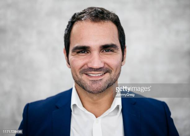 formal portrait of cheerful latin american businessman - colletto aperto foto e immagini stock