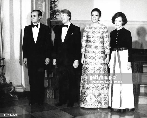 Formal portrait of US President Jimmy Carter ,and First Lady Rosalynn Carter as they host the Shah of Iran Mohammed Reza Pahlavi and Shahbanu of Iran...