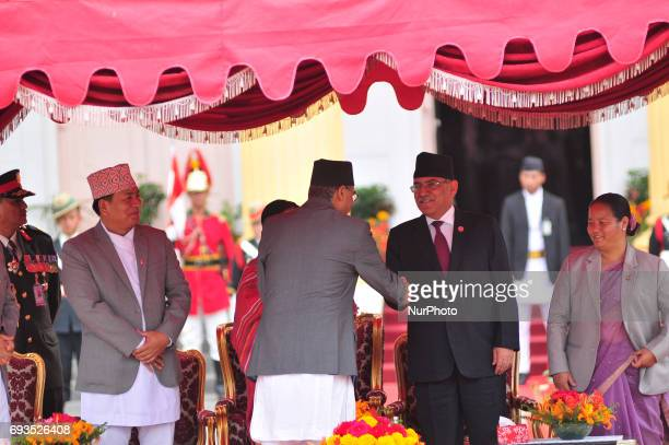 Formal Prime Minister Puspa Kamal Dahal greets Newly elected Prime Minister of Nepal Sher Bahadur Deuba after taking an oath of office and secrecy at...
