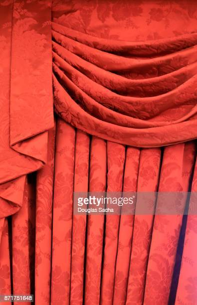 formal red fabric curtain covers the theaters stage - ドレープ ストックフォトと画像