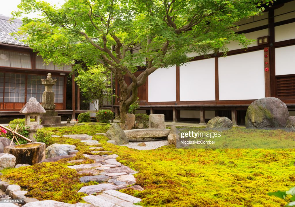 Formal rock and moss garden at Japanese Buddhist temple : Stock Photo