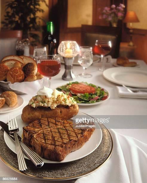 formal steak baked potato dinner - bistecca alla fiorentina foto e immagini stock