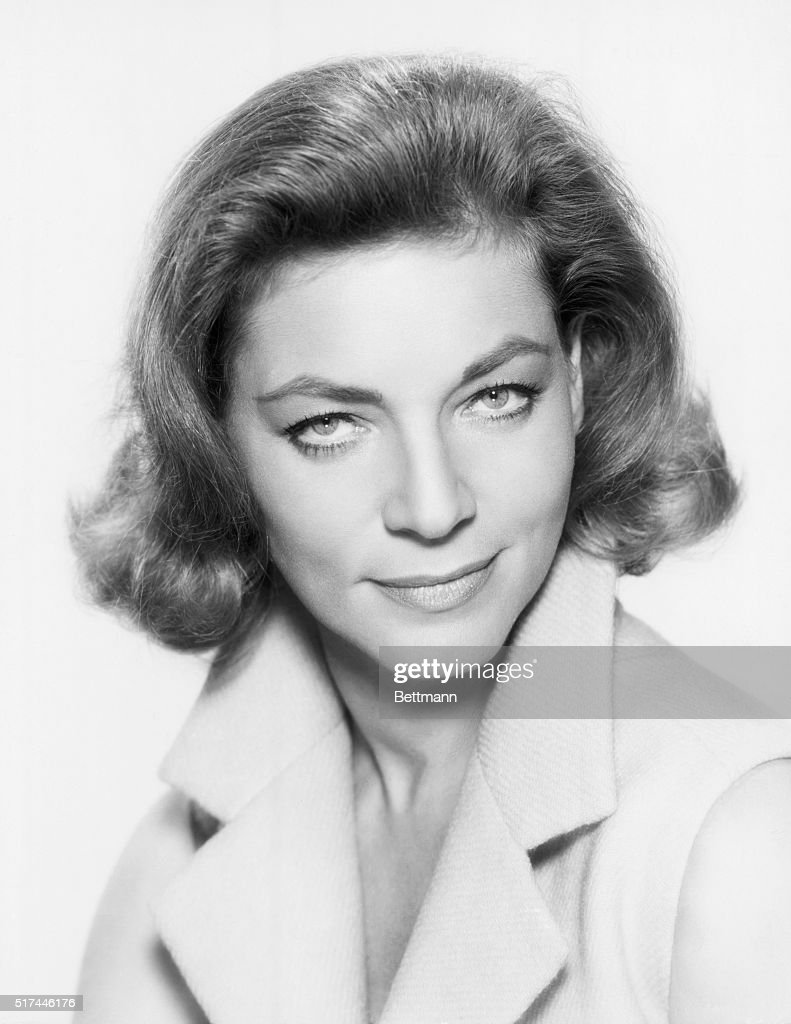 Formal, studio, headshot of actress Lauren Bacall with her chin down and her eyes looking up. Undated photograph.