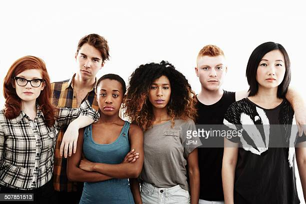 formal studio portrait of six serious young adults - arms crossed stock pictures, royalty-free photos & images
