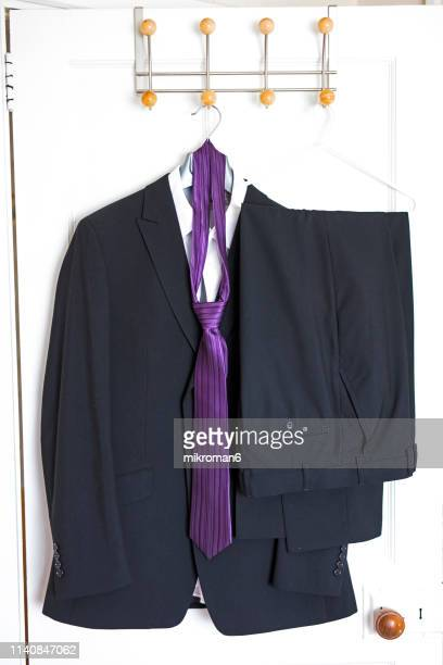 formal wear hanging on door - striped blazer stock pictures, royalty-free photos & images