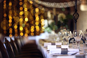 Formal wedding place setting on long table background