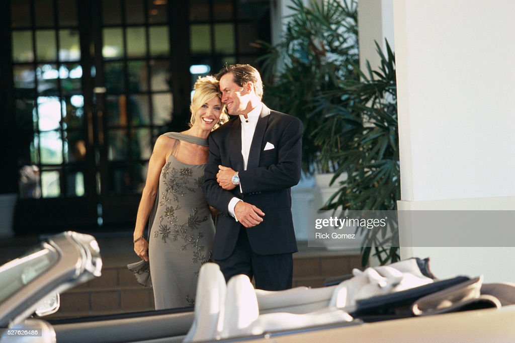 Formally Dressed Couple Walking To Car Stock Photo Getty Images