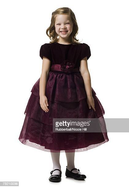 Formally dressed girl smiling