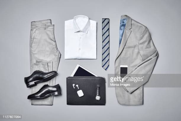 formalwear arranged on gray background - gray pants stock pictures, royalty-free photos & images