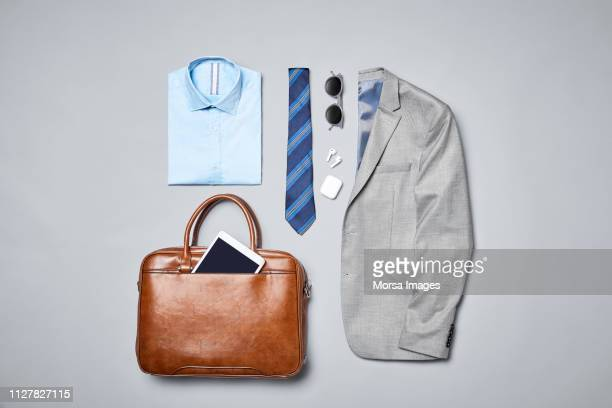 formalwear arranged on gray background - camicia foto e immagini stock