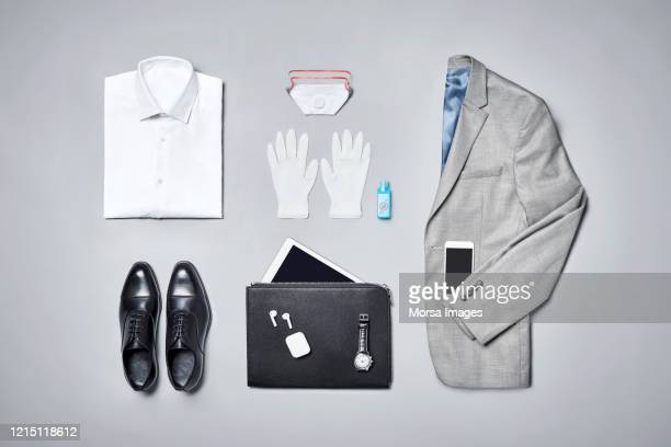 formalwear arranged on gray background - panic buying stock pictures, royalty-free photos & images