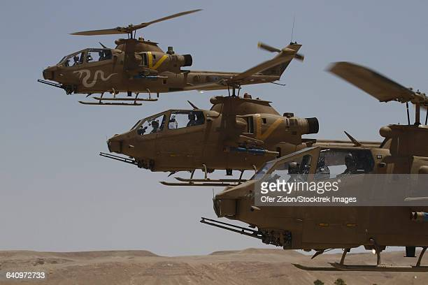 Formation landing of AH-1 Tzefa helicopters from the Israel Air Force.