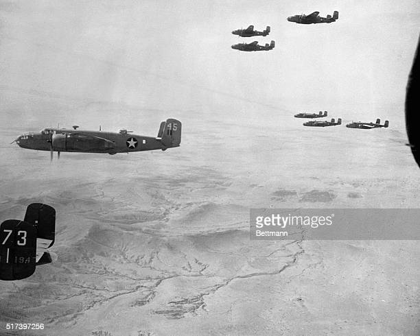 A formation of American B25 Bombers is shown after taking off from an advanced base in Tripolitania The ships are en route to bomb the Mareth line...