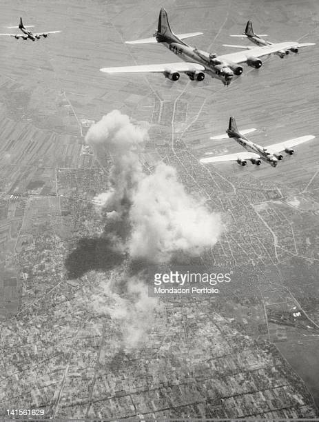 Formation of B17 'Flying Fortress' of the 15th Aircraft Force bombing on Subotica railway network from which smoke for fire and explosions is coming...