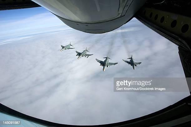 Formation of Luftwaffe F-4F Phantom II's behind a tanker.