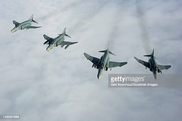 formation of luftwaffe f-4f phantom ii's. - military convoy stock photos and pictures