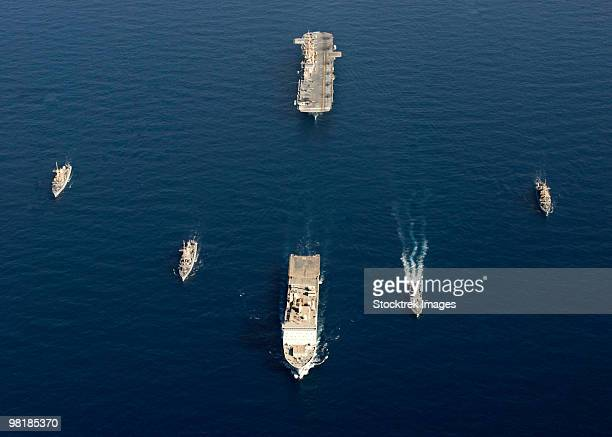 a formation of ships at sea. - royal navy stock pictures, royalty-free photos & images
