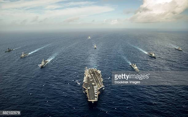 Formation of ships from the U.S. Navy, Indian Navy, and the Japan Self Defense Force.
