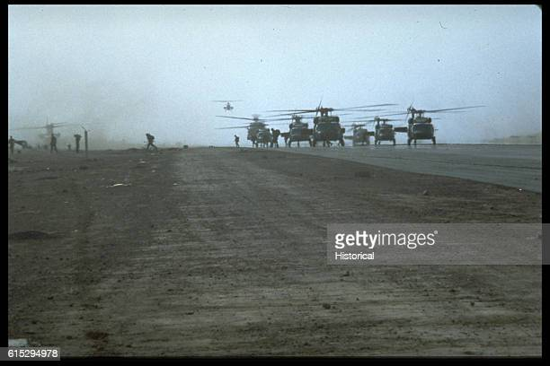 A formation of UH60 Black Hawk helicopters land at Point Salinas airfield during the multiservices multinational Operation Urgent Fury A AH1 Sea...