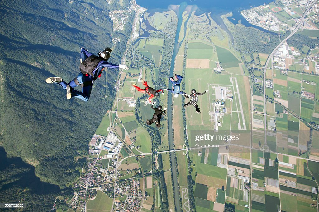 Formation skydiving team is getting filmed : Stock Photo