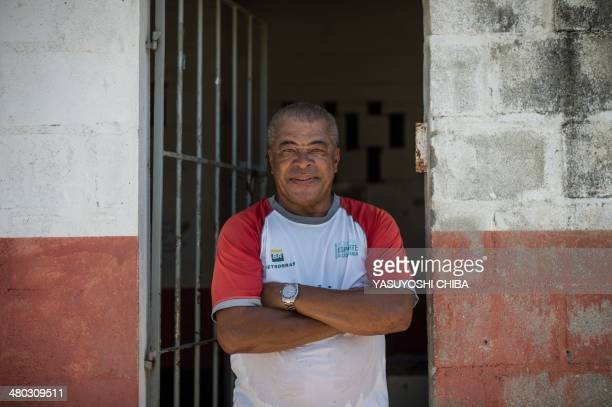 Formber Brazilian football player Jair Ventura Filho aka Jairzinho poses after coaching youngsters during a project to find a talent at Varginha...