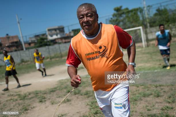 Formber Brazilian football player Jair Ventura Filho aka Jairzinho coaches youngsters during a project to find a talent at Varginha shantytown in Rio...