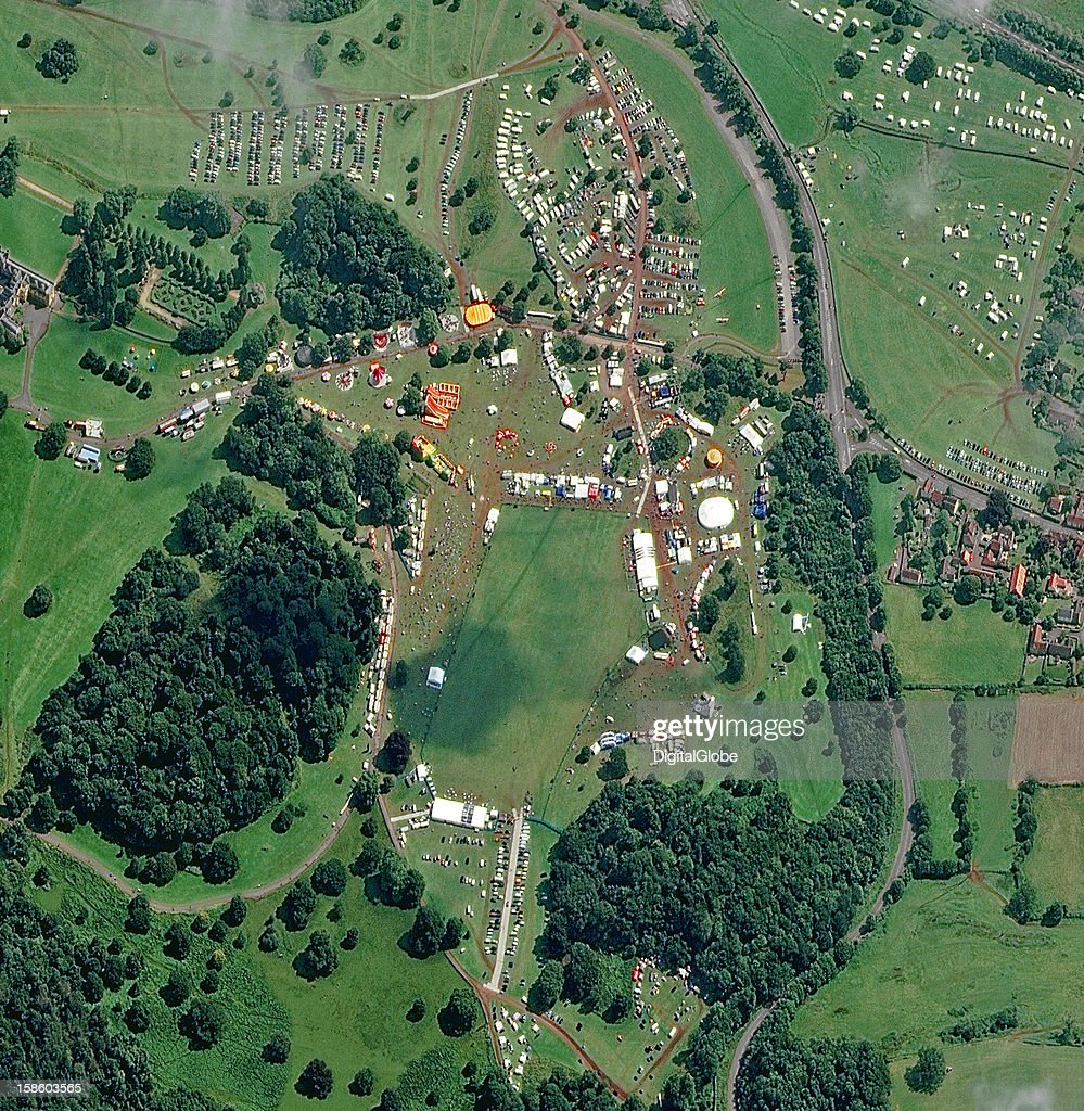 Formed in 1979, the Bristol International Balloon Fiesta began with a small gathering of like-minded balloonists. The event started on 09 August and continued through 12 August with hot air balloon launches taking place at 6 am and 6 pm. Taken the last day of the festival this image shows the balloon launch field, balloonist village, fun fair and activity zone.