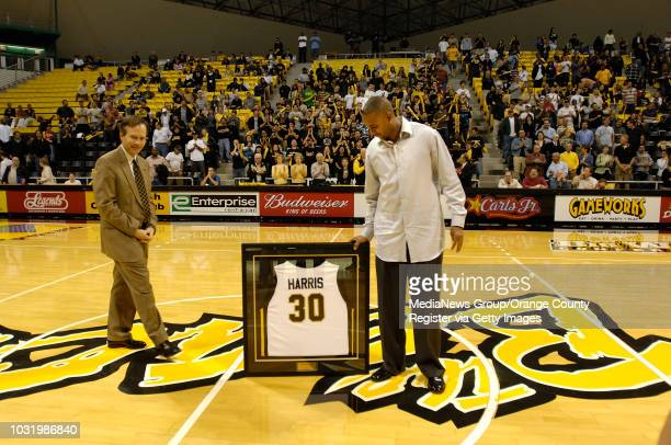 BEACH Former 49er Lucious Harris right checks out his framed jersey with CSULB President F King Alexander during a halftime ceremony Saturday Febuary...