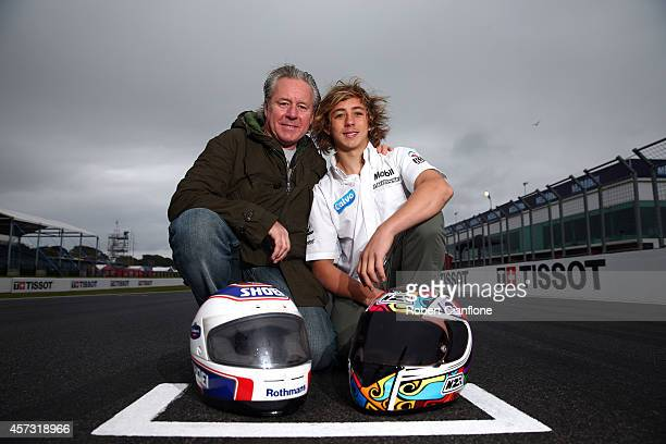 Former 500cc World Champion Wayne Gardner poses with his son Remy ahead of the 2014 MotoGP of Australia at Phillip Island Grand Prix Circuit on...